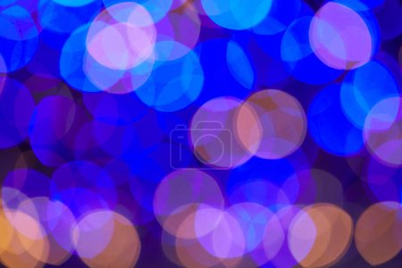 blue and violet shiny bokeh christmas background