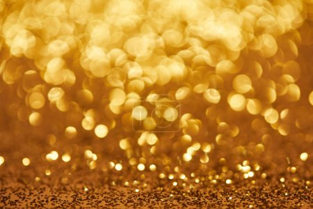 Photo for Golden bokeh christmas background with glittering sequins - Royalty Free Image