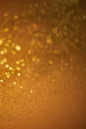 golden bokeh christmas background with falling glittering sequins