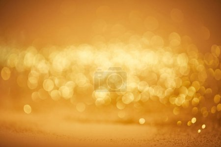 Photo for Golden bokeh christmas background with glossing sequins - Royalty Free Image