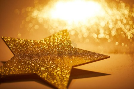 Photo for Golden shiny star for christmas decoration on tabletop - Royalty Free Image