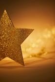 golden glittering star for christmas decoration