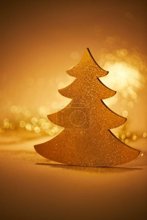 golden glittering christmas tree for decoration on tabletop