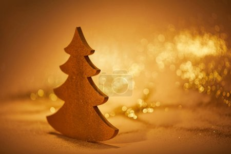 golden glossing christmas tree for decoration on tabletop