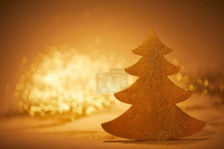 golden sparkling christmas tree for decoration on tabletop