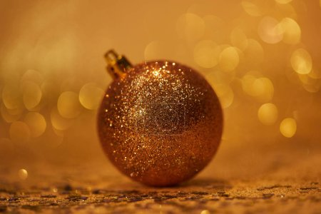 golden glossing christmas ball for decoration on tabletop