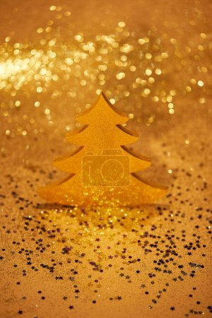golden festive christmas tree for decoration with glittering background