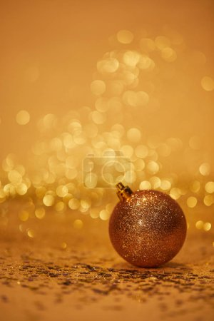Photo for Golden glittering christmas toy for decoration on tabletop - Royalty Free Image