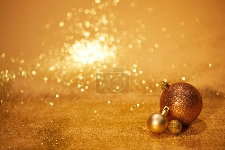 Photo for Golden glittering christmas toys for decoration on tabletop - Royalty Free Image