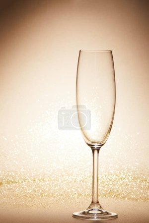 empty wineglass with glitter on tabletop, christmas concept