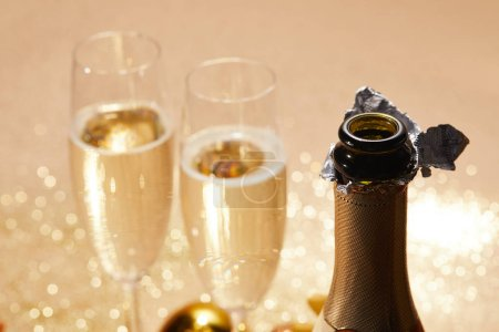 selective focus of open champagne bottle, christmas concept