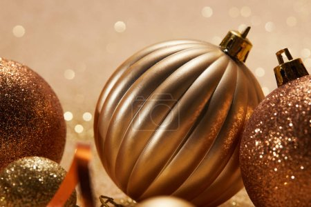 close up of glittering bright christmas balls on beige background