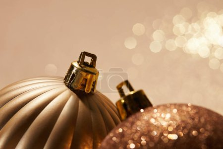 close up of sparkling bright christmas balls on beige background