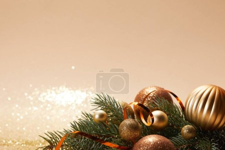 Photo for Glittering christmas balls and pine branch on sparkling tabletop - Royalty Free Image