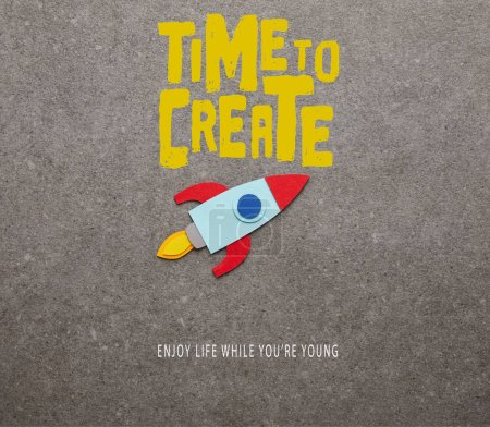 "Photo for Colorful handmade rocket on gray background with ""time to create"" inspiration - Royalty Free Image"