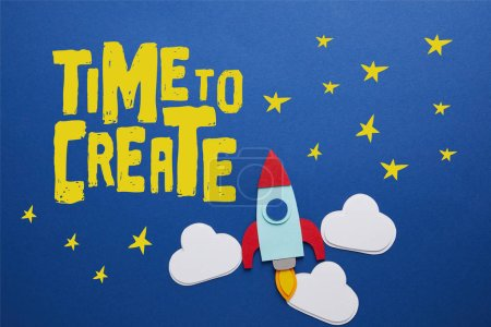 "clouds and rocket on blue background with ""time to create"" inspiration"