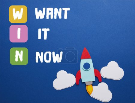 "clouds and rocket on blue background with ""WIN - want it now"" inspiration"