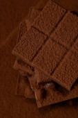 close-up view of sweet gourmet chocolate pieces and cocoa powder
