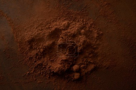 top view of delicious cocoa powder on dark background