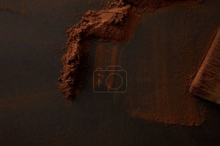 Photo for Top view of gourmet cocoa powder on black background - Royalty Free Image