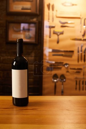 close-up shot of bottle of red wine on wooden table