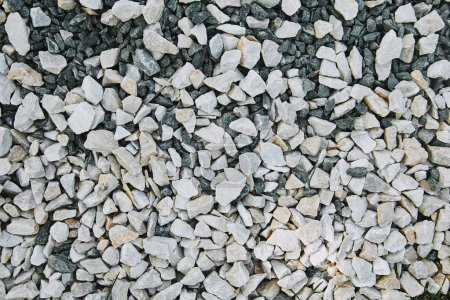 top view of white small scattered stones on ground