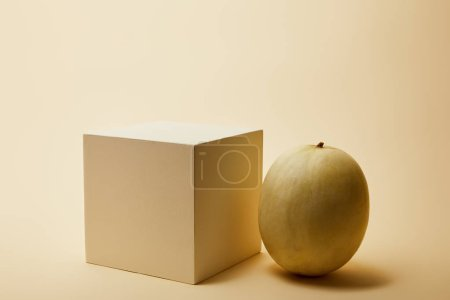 close-up shot of ripe melon and cube on beige surface