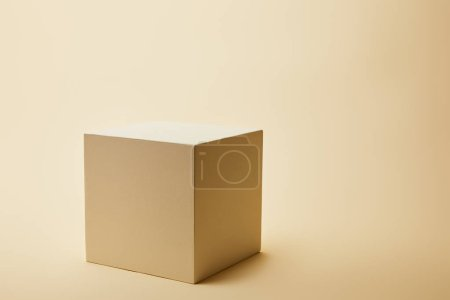 close-up shot of single cube on beige surface