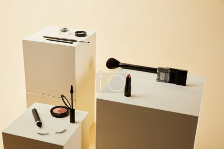 various makeup accessories kit on beige cubes