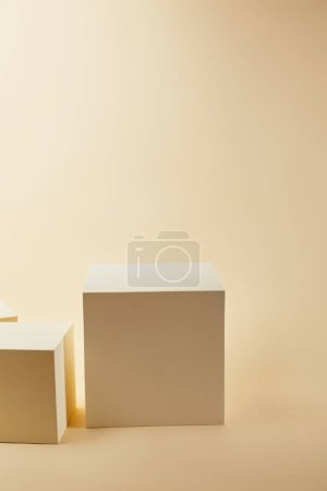 cubes in various sizes on beige surface