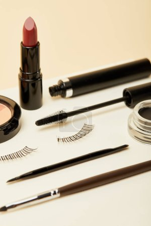 close-up shot of makeup accessories kit on beige