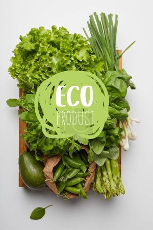 "Photo for Top view of various ripe vegetables in box on white surface with ""eco product"" lettering - Royalty Free Image"