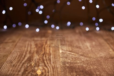 close up view of wooden tabletop and defocused bokeh lights backdrop