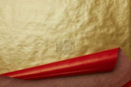 full frame of red and golden wrapping papers as background