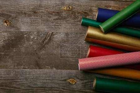 top view of arranged wrapping papers of different colors on wooden background