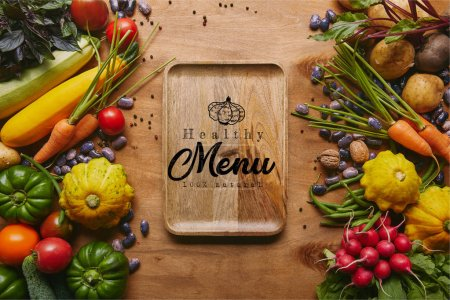 "Photo for Organic raw vegetables and tray with ""healthy menu"" lettering on wooden table - Royalty Free Image"