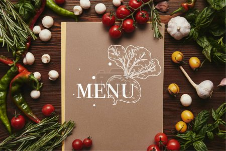 top view of menu and fresh vegetables with herbs on wooden surface