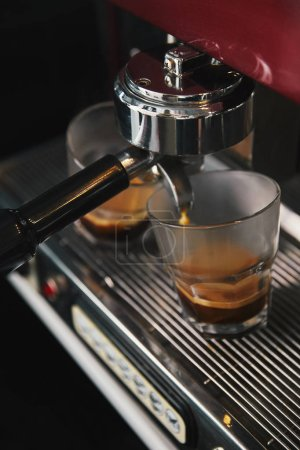 professional coffee machine and two glasses with espresso