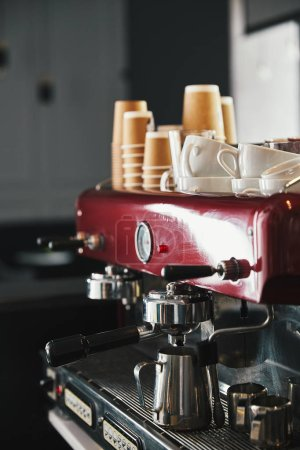 Photo for Professional coffee machine with mugs and paper cups in coffeehouse - Royalty Free Image
