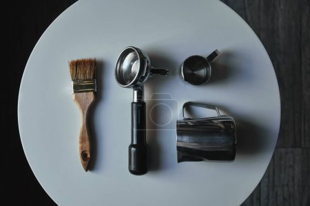 Photo for Top view of professional tools for preparing coffee on round grey table - Royalty Free Image