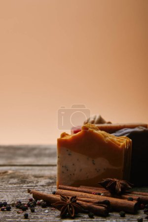 close-up shot of homemade soap with spices on rustic wooden tabletop