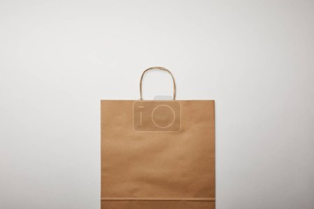 flat lay with food delivery paper bag on white surface, minimalistic concept