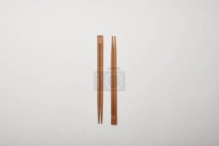 top view of arranged chopsticks on white surface, minimalistic concept