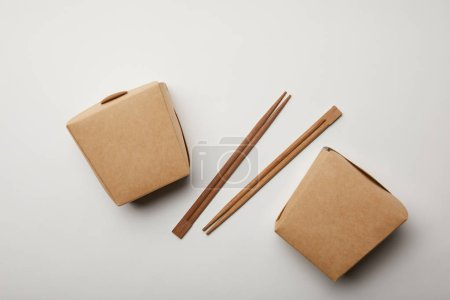 Photo for Flay lay with arranged chopsticks and noodle boxes on white surface, minimalistic concept - Royalty Free Image