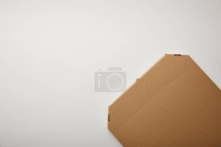 top view of cardboard pizza box on white surface, minimalistic concept