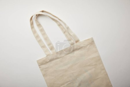 elevated view of cotton bag on white surface, minimalistic concept