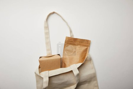 Photo for Top view of cotton bag with cardboard noodle box on white surface - Royalty Free Image