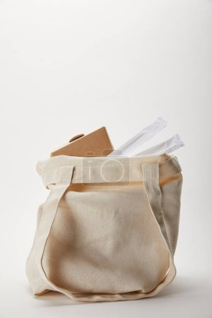 Photo for Close up view of cotton bag with chopsticks and noodle box on white - Royalty Free Image