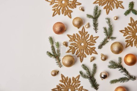 top view of Christmas snowflakes, baubles and fir twigs isolated on white