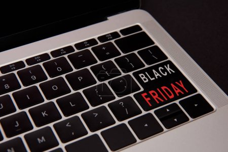close-up shot of laptop keyboard with black friday button isolated on black